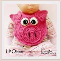 Pig Drool Bib by Darleen Hopkins https://crochetbydarleenhopkins.com/patterns/bib-pig/