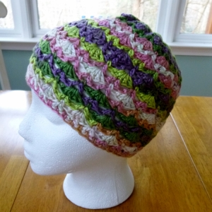 https://crochetbydarleenhopkins.com/category/2014-chemo-hat-challenge/  Shells and Trellis hat for Halos of Hope