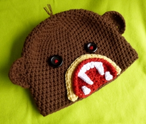 Zombie Monkey Hat crochet pattern by Darleen Hopkins http://www.ravelry.com/projects/DarleenHopkins/zombie-sock-monkey-attacks-hat-with-or-without-earflaps-2