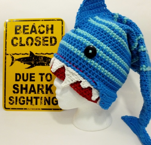 Shark hat crocheted by Darleen Hopkins https://crochetbydarleenhopkins.com/category/2014-chemo-hat-challenge/