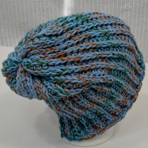 Willow Tree Slouchy http://www.ravelry.com/projects/DarleenHopkins/chunky-willow-tree-slouchy-beanie