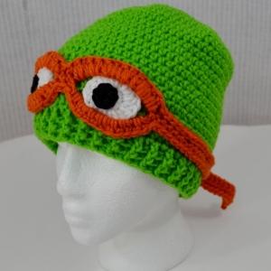Ninja Turtle hat crocheted by Darleen Hopkins  https://crochetbydarleenhopkins.com/patterns/