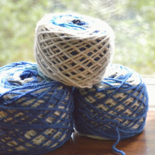 magic balls of yarn made with scraps to be used for crocheting a lapghan for donation