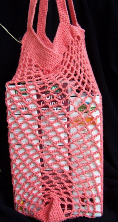 Market bag crocheted from a thrift store sweater. Upcycled, reclaimed yarn.
