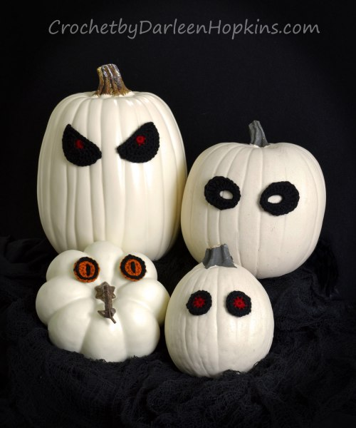 Ghost pumpkins with crocheted eyes. Pattern by Darleen Hopkins