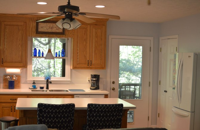 Oak-wood-cabinets-white-countertop-blue-walls-oiled-bronze-fixtures-hardware-kitchen-oak-floors-5