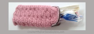 crocheted eyeglass case used to hold plastic utensils