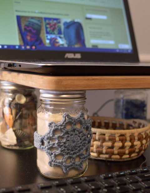 DIY laptop stand made with mason jars and cutting board