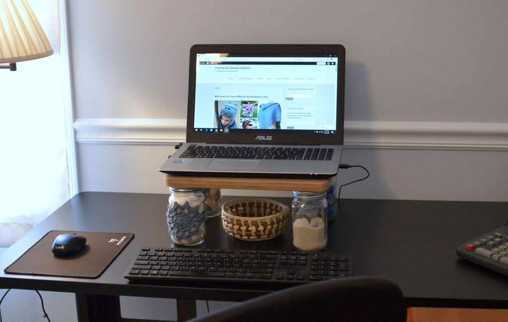 DIY laptop stand made with mason jars and old cutting board decorated with crochet